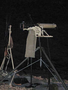 A big gun. At night.